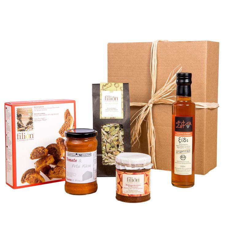 "Filions ""red christmas"" present box full of greek mediterranean delicacies..Enjoy Christmas time and order @ www.filion.eu"