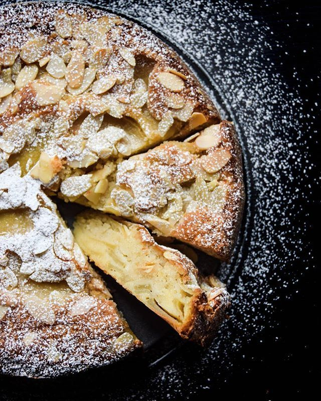 Fragrant almond cake with custard-like bottom and crisp top with a variety of sweet and tart apples.