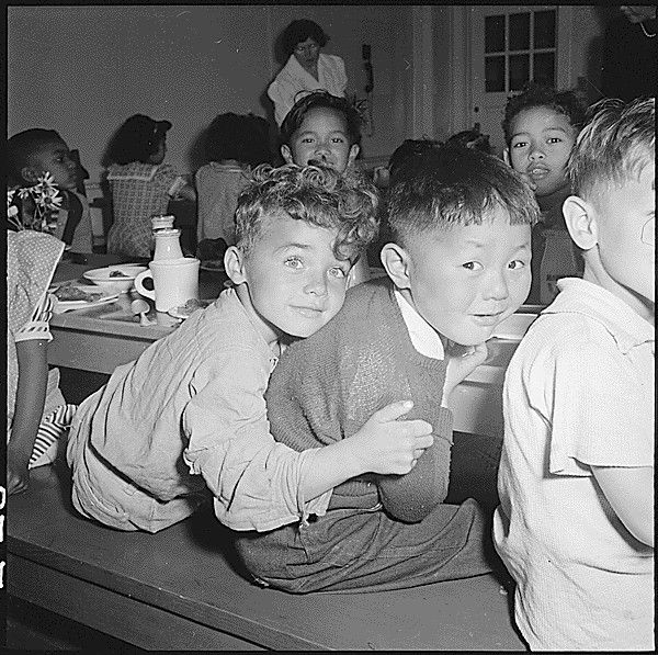 At a lunchroom in San Francisco. This picture was taken just before the boy on the right was taken to a relocation center. (1942, Dorothea Lange)