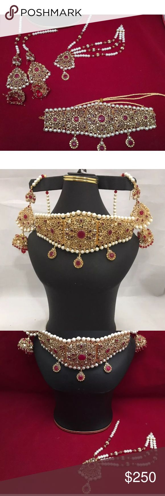NWOT Indian Bollywood jewelry set NWOT Indian latest bridal Jaraao choker style jewelry set . Include big Jaraao choker mid wider part is 3.5 inches long . Full length of choker is 8 inches attached with rope to make loose or tight .Long jhomki style earrings are 5 inches long comes with saharas .Matha patti is one side style . Set attached with rhinestones, and imitation red stones and big Pearl Beads. Extremely beautiful in front and very big set pictures are not doing justice. Jewelry…
