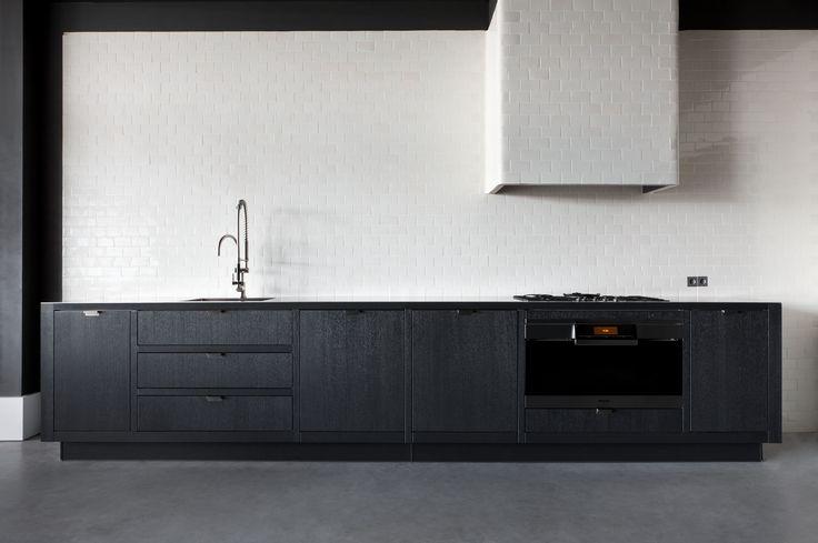 Kitchens - Piet Boon by WARENDORF - STOCKHOLM - Dark oak veneer combined with a 4mm brushed RVS worktop / tiles
