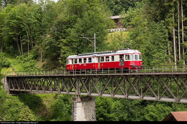 Electric railcar BDe 4/4 # 2 of the former Wohlen-Meisterschwanden Bahn (WM), built in 1966 and in service on this only 8.2 kilometer long line till 1997. From then till 2004 running for the Südostbahn, now with Depot und Schienenfahrzeuge Koblenz (DSF). The railcar is on a birthday charter trip over the line (Hinwil)-Bäretswil-Bauma of the DVZO and is crossing the 79 meter long Weissenbach viaduct at Neuthal.