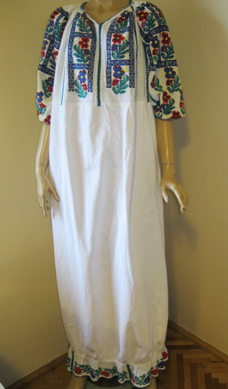 Splendid antique Romanian traditional blouse dress from Muscel area. The dress is hand embroidered with multicolored cotton thread on white linen..  available at www.greatblouses.com