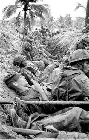 Vietnam war   The Unit on the Vietnam War I think these soldiers were just in combat with the north for a long time and the north just retreated. They all look really tired and are probably wanting to go home and see there friends and family. But most if them are probably going to eat the c- rations before the north Vietnamese come back a second attack again. I wonder how long they have been sitting there?
