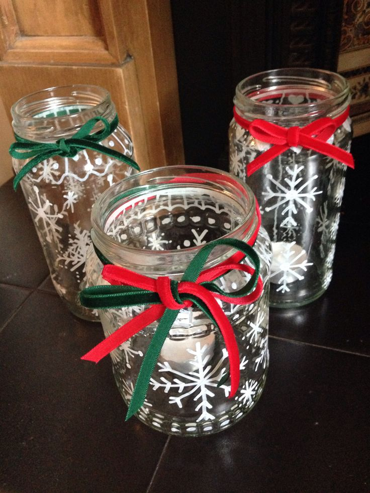Christmas Tea Light Holders: Old jars, white marker pen, snowflakes and ribbon