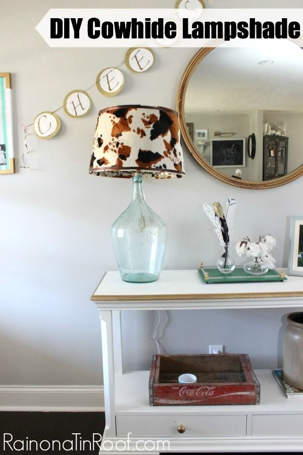 Make this one for $15 instead of buying the Pottery Barn one for $100. DIY Cowhide Lampshade via RainonaTinRoof.com #cowhide #knockoff #diy