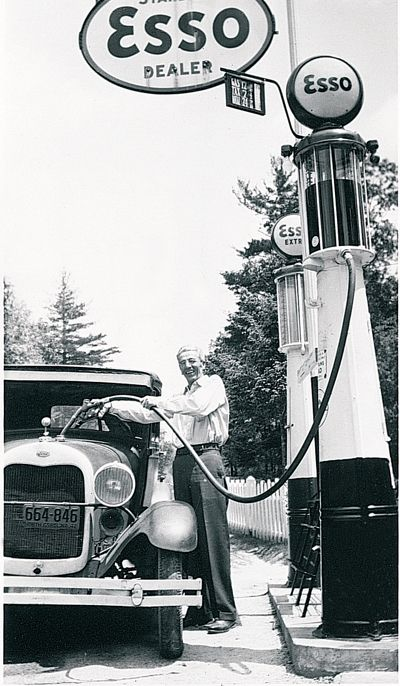 """Leslie Lease, originally from Kenosha, Wisconsin, filling up a 1920s-era car from a gravity-feed pump at a station in North Carolina,"""" notes Bob Durling of Highland, Indiana. """"The license plate reveals the year to be 1942. Check out the gas price of under 25 cents, including tax. ON back of the photo is written 'Leslie's first and only customer…Toxaway Lodge, taking Mr. Reid's place."""""""