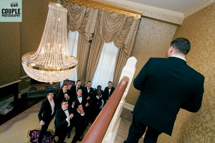 The Groom comes down to be greeted by his groomsmen in the Presidential Suite at the Westin, by http://www.couple.ie