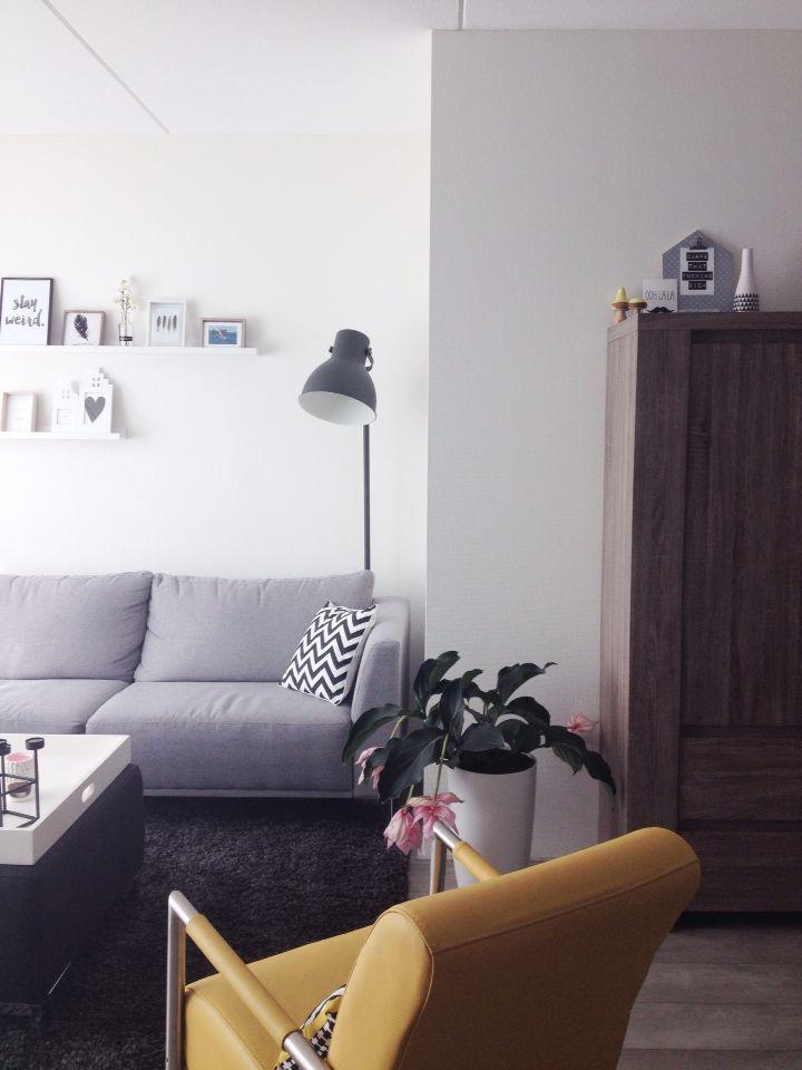 Livingroom, yellow fauteuil, grey couch, shelves, hektar lamp Ikea