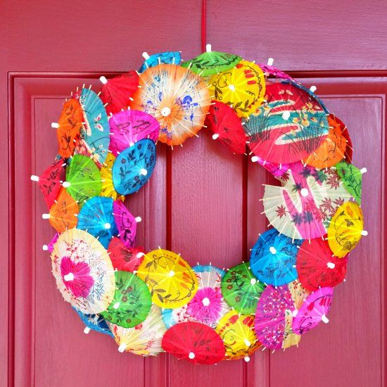 Use pretty cocktail umbrellas / parasols to create this whimsical wreath, perfect for summer!