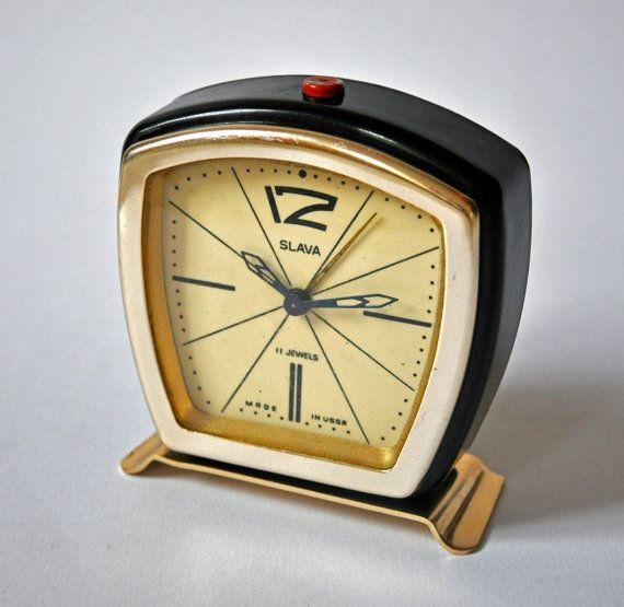 "Vintage Soviet small alarm clock ""Slava""."