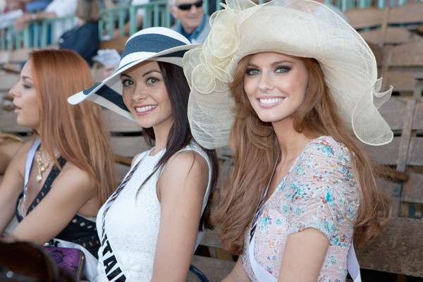 Miss Great Britain 2011 Chloe-Beth Morgan, center, and Miss USA 2011 Alyssa Campanella, right, at the Jockey Club in Sao Paulo, Brazil.