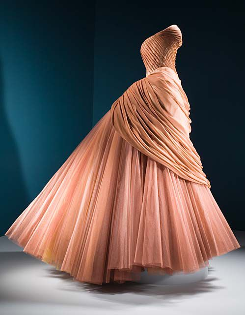 "Evening Gown, Charles James: 1951, silk chiffon, silk satin and nylon chiffon. ""Charles James, considered an architect of dress, was obsessed with the nuances of his complicated constructed designs. This gown, with its massive billowing skirt, is composed of layer upon layer of silk, boning, horsehair, and crinoline."" LACMA Collections Online"