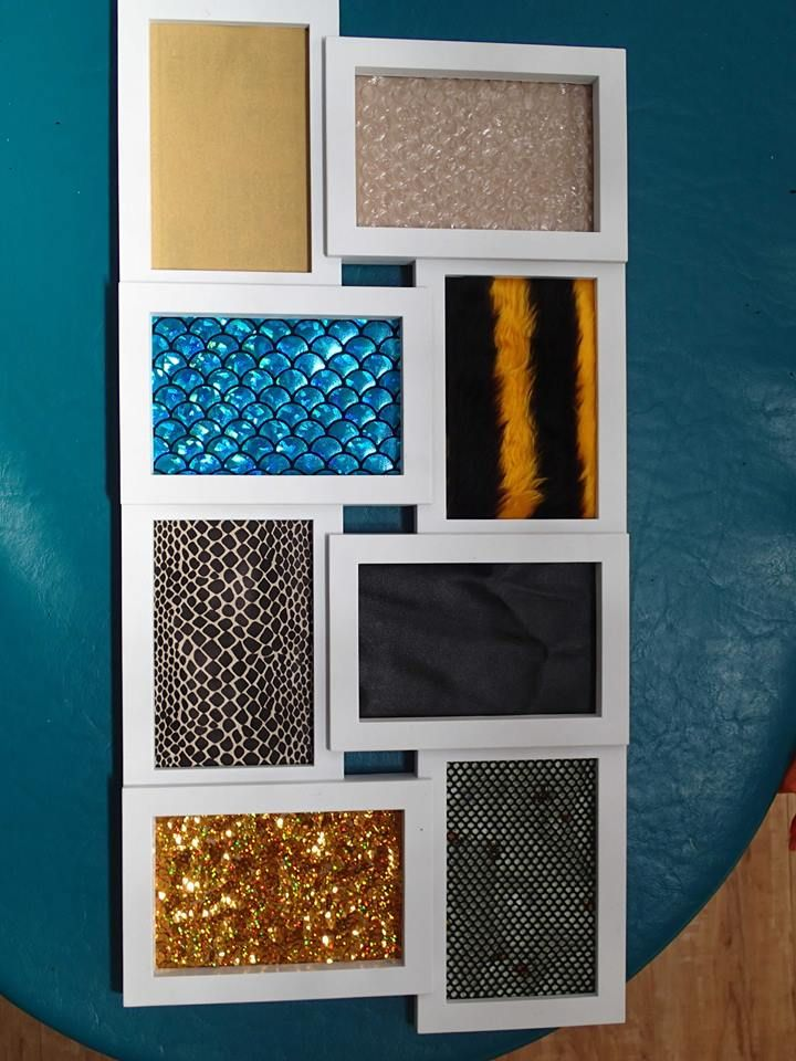 Sensory board made from a photo frame - bubble wrap, fine sand paper, silk fish scales, tiger fur, snake skin, leather, sequined material and fishnet over bees. Cheryl's Family Day Care ≈≈