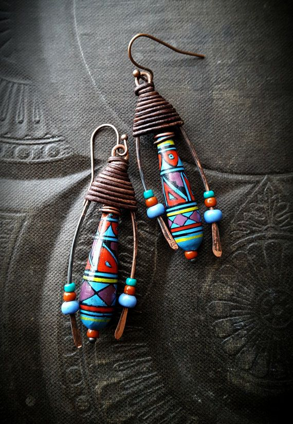 magnificent artisan hand painted Peruvian clay drops, they hang inside darkened copper open ended hoops with old African blue glass and seed glass beads attached, lovely aged chocolate leather wrapping at the top, finished off with copper ear wires.  These are truly a work of art ♥ •very light weight •Unique as you can get! •very earthy and organic •Original work of Yucca Bloom♥