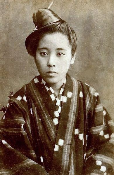 Portrait of a young woman from Okinawa, Japan, wearing an ikat-designed kimono. Late 19th century by unknown photographer