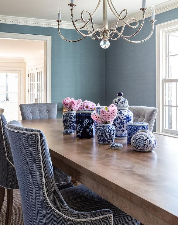 Blue Upholstered Herringbone Chairs With Nailhead Trim Pairs With A Rectangular Wood Dining Table Showcasing C Dining Room Decor Decor Dining Table Centerpiece