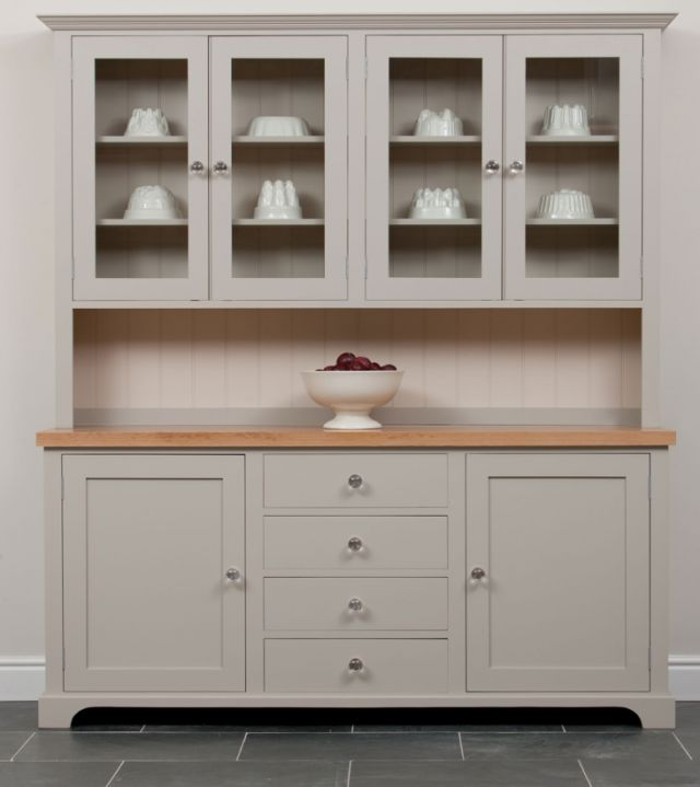 Light greige dresser with shaker style cabinets.