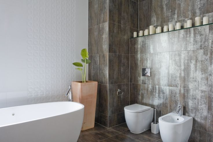 Textured Wall Details With White Amenities