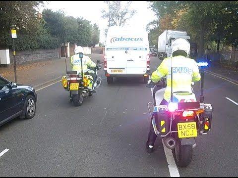 Police bikes escorting vans through Birmingham