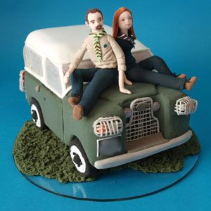 guide bride and scout groom on a landrover handmade personalised wedding cake topper