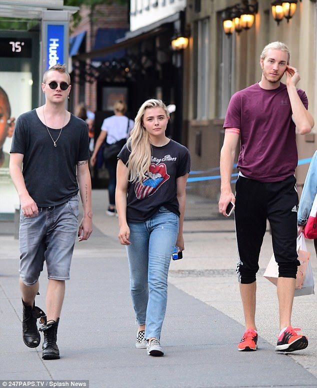 Family affair: Chloe Grace Moretz (C) walks in New York City with brothers Colin (L) and Trevor (R) on Thursday