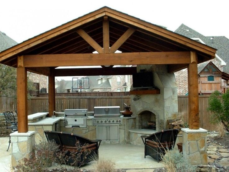 Traditional Pergola Also Corner Stone Fireplace Design Feat Black Wicker Chairs And Simple Outdoor Kitchen Plan