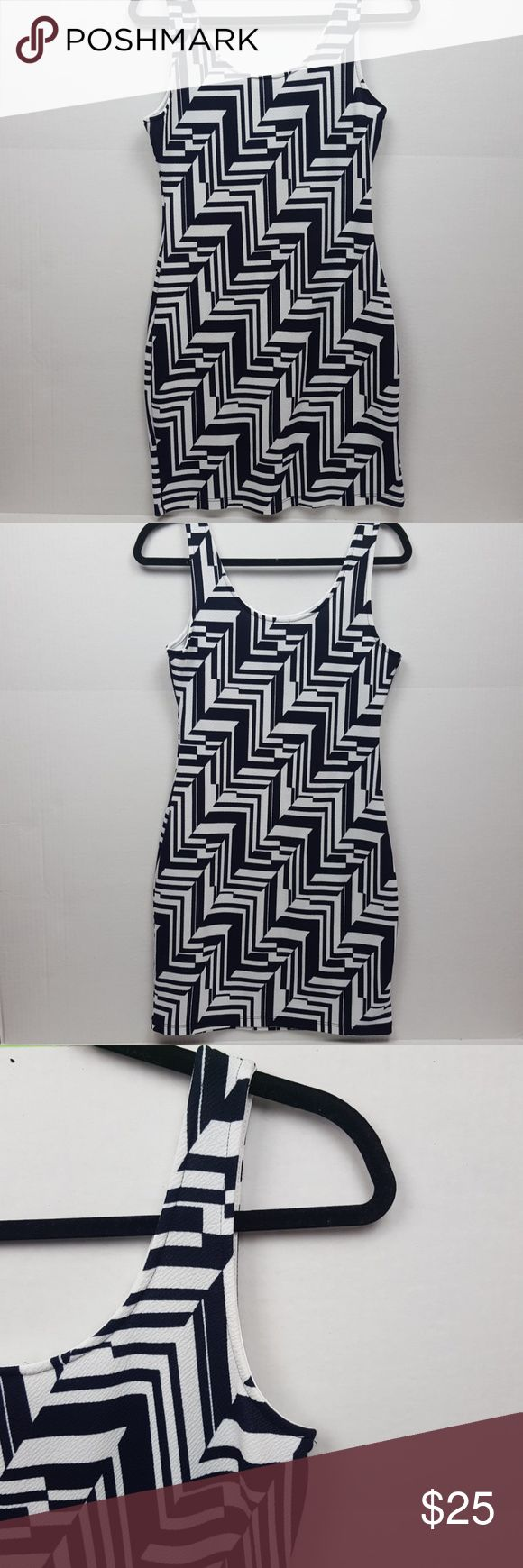 Soprano black and white geometric bodycon dress This is a Soprano black and white bodycon mini dress with a Aztec/geometric print. The dress is in excellent used condition and perfect for a New Years party. Made in USA. Geometric party/evening dress.  Materials - 95% polyester 5% spandex Soprano Dresses Mini