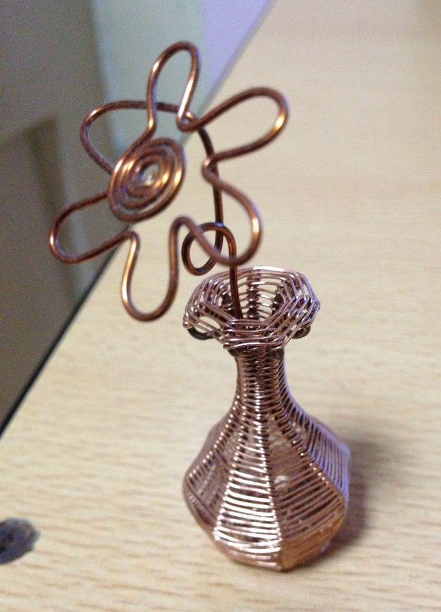 Búcaro con flor de cobre