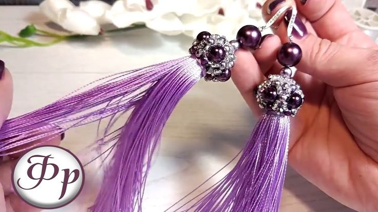 Earrings with brushes. A beautiful cap of beads and beads.