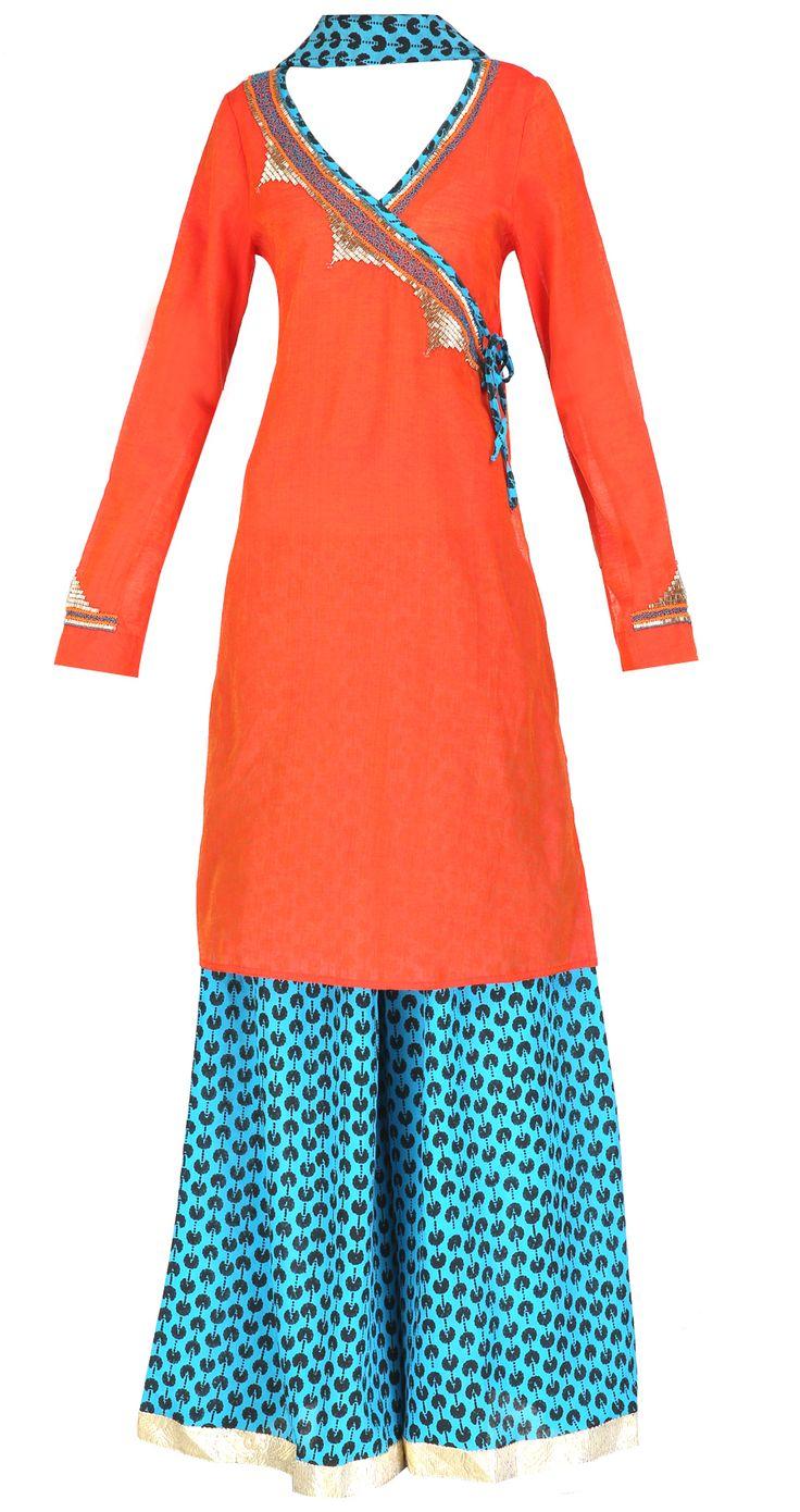 Orange angrakha style tunic with sharara pants and dupatta by Surendri/Yogesh Chaudhary Shop at https://www.perniaspopupshop.com/whats-new/surendri-yogesh-chaudhary