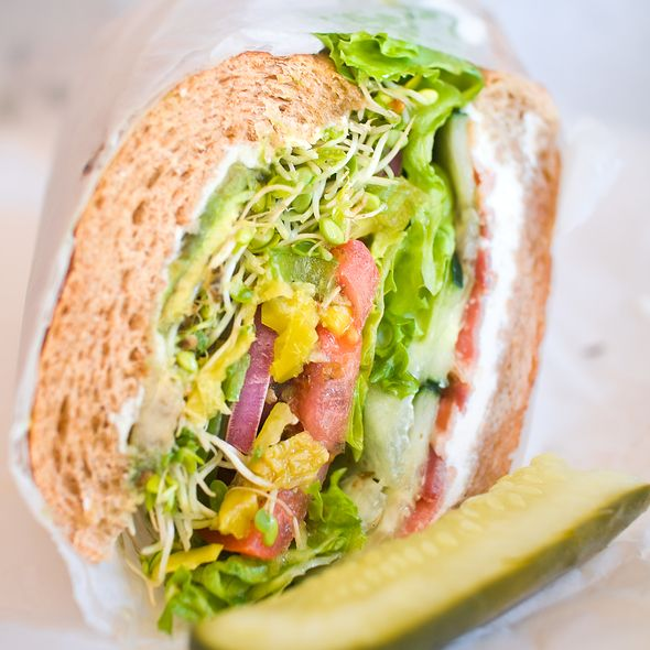 Garden Veggie Sandwich   Cream cheese with oil, avocado, cucumber, lettuce, tomato, onions, pepperoncini, olives, sprouts, bacon on whole wheat roll