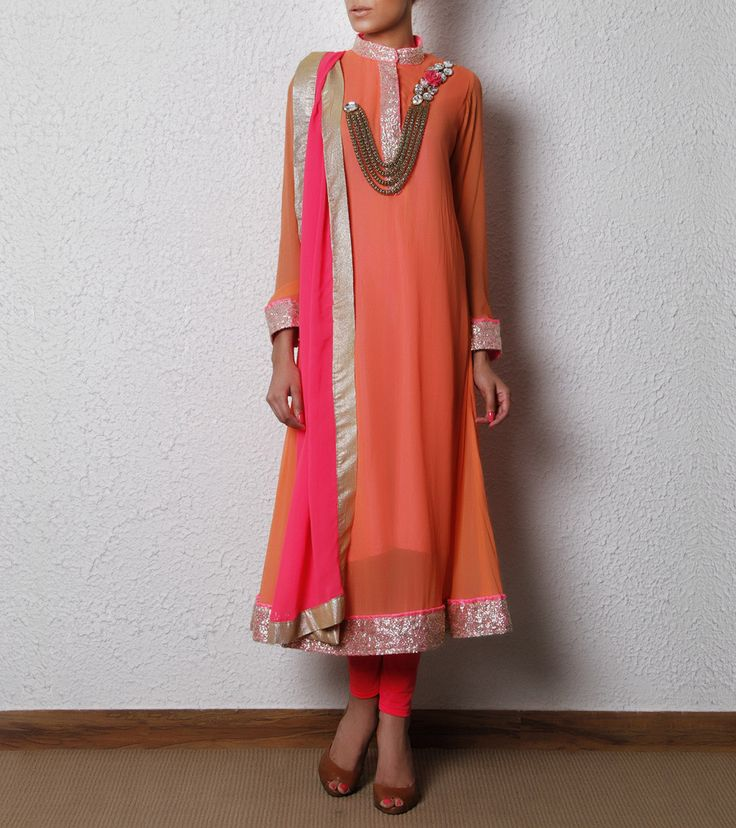 Peach Suit. his is a peach and pink georgette suit embellished with crystals and beads.  It has a silver mandarin collar, border and cuffs.  Dupatta is made of georgette and churidar is made of lycra net