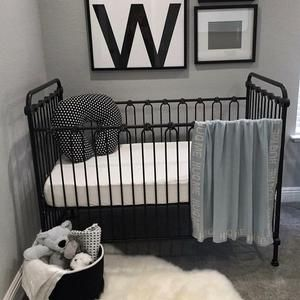 Make a strong yet chic statement with a black and white boy nursery.  Simple and clean. #nursery #boy #furniture