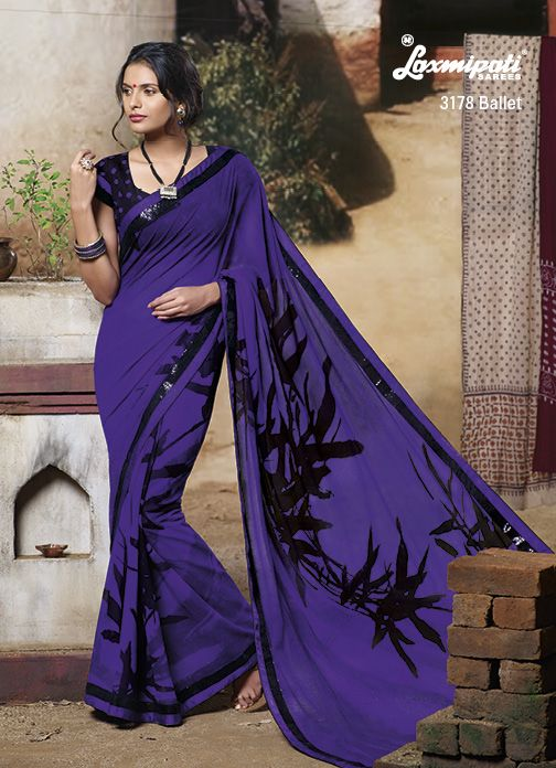 Everything about Florence seems to be colored with a mild violet- This beautiful violet colored saree with abstract prints.