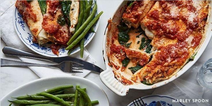 Recept: Canneloni van tortilla's met spinazie-tomatensaus- Menshealth.nl