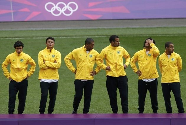 Brazil's players react before the medal ceremony after losing to Mexico in their men's soccer final gold medal match at Wembley Stadium during the London 2012 Olympic Games August 11, 2012