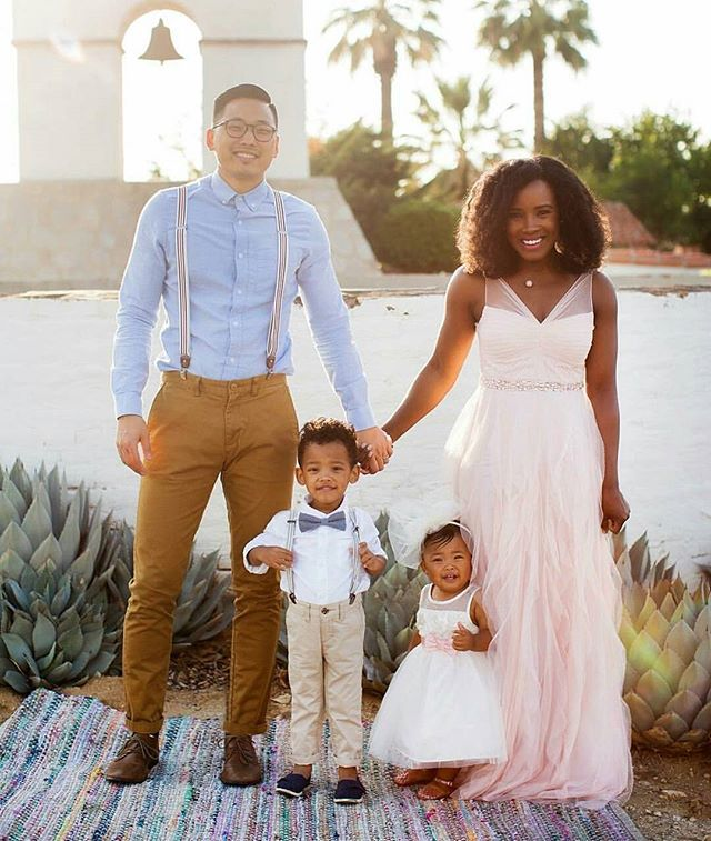 Interracial couple with biracial children. Love. Family love.