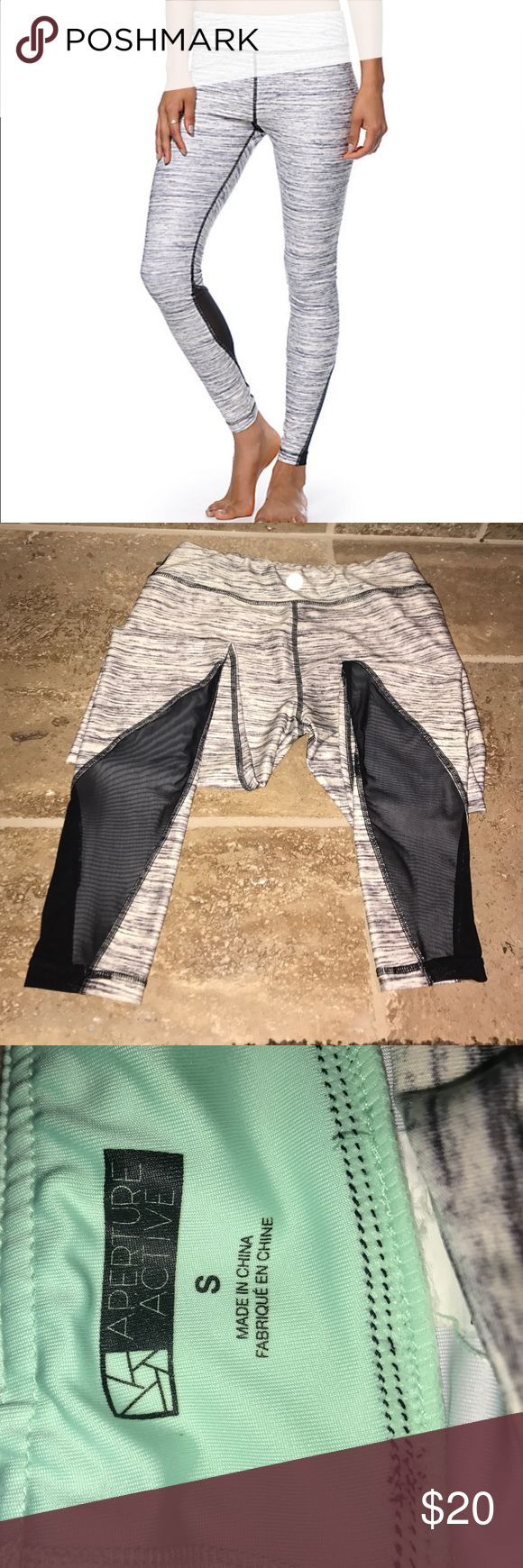 Gray and black mesh long athletic pants Gray and cream long satin feel leggings with black mesh on the calves. I've worn these to barre and the gym and received lots of compliments. Aperture Active Pants Leggings