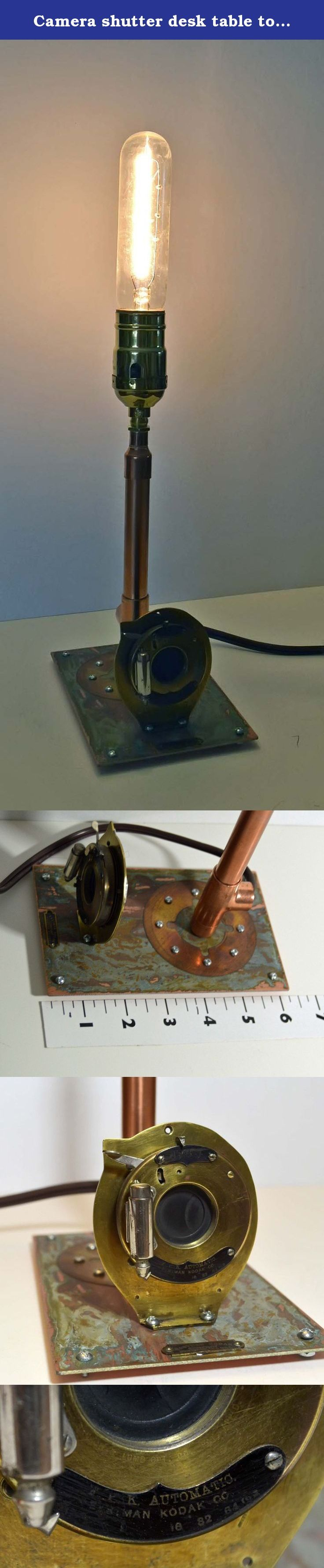 Camera shutter desk table top lamp light recycled PC board handmade OOAK hand signed sculpture for desk shelf or table working shutter mechanism Stands 14 tall with bulb. This a a great gift, a table top lamp created with a antique brass camera shutter mechanism that still works! includes pictured light bulb, fits standard size bulbs. also copper pipe and scrap PC board 14 x 6 x 4.
