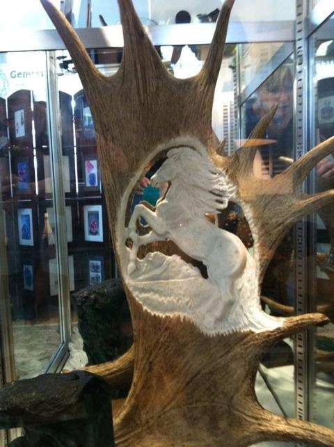 wild horse carving in antler on display by Roni Dietrich This piece is for sale