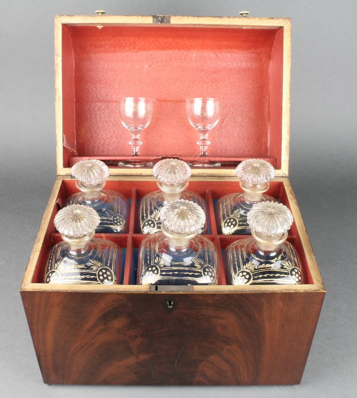 Lot 102, A 19th Century mahogany dome topped liqueur box containing 6 square gilt decorated decanters with mushroom stoppers and 2 spirit glasses, sold for £250