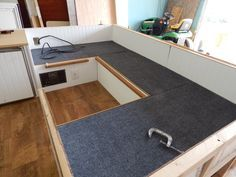 Put outdoor carpet on the seat tops - that raw wood under the cushions just seems wrong!