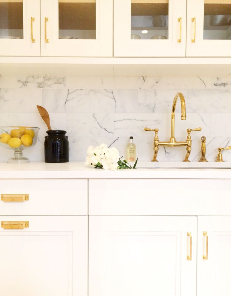 Brass hardware in a white kitchen by kapito muller interiors follow on