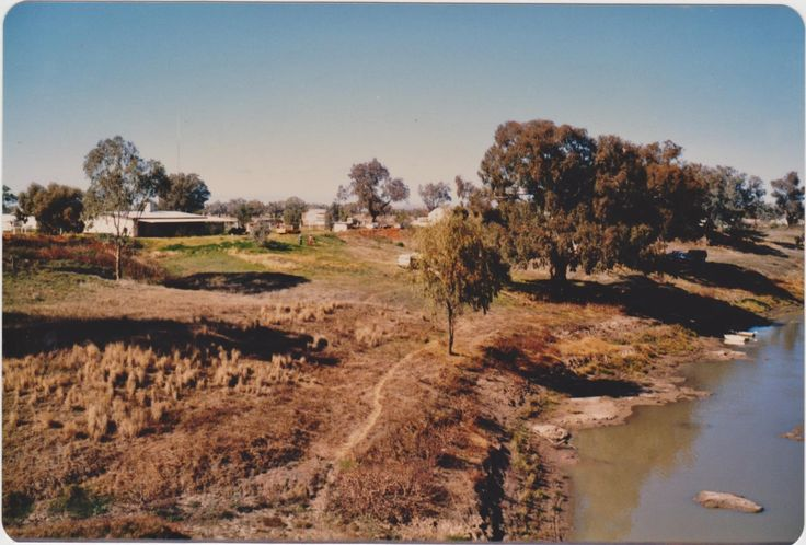 Louth 1985. Looking at the back  of Louth from the bridge, large building, Shindy`s Inn. Grace Marsh & sons camped beside the Darling River.
