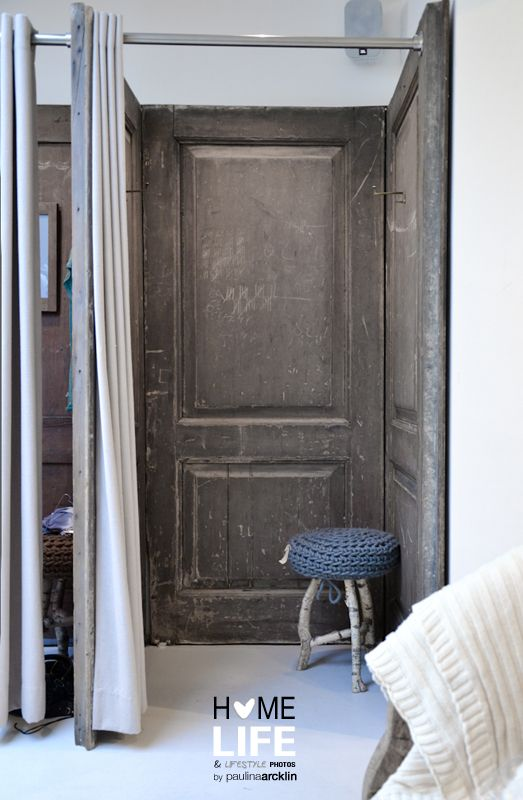 Build your own closet using doors. Could add shelves and rods to this.