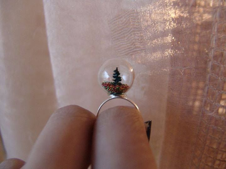 "Check out this amazing Christmas tree in that tiny little glass bubble!  They don't come more amazing than this.  It's Christmas all around you when you wear it :)   This is the ""Where did all the ornament go?"" ( get it? because they fall off the tree :P )   #diy #handmade #christmas #rings"