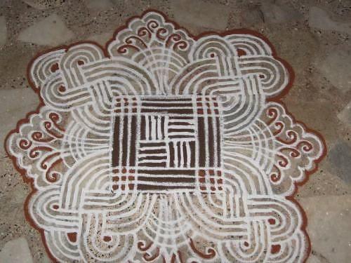 Kolam rangoli alpana design with lines and flowers