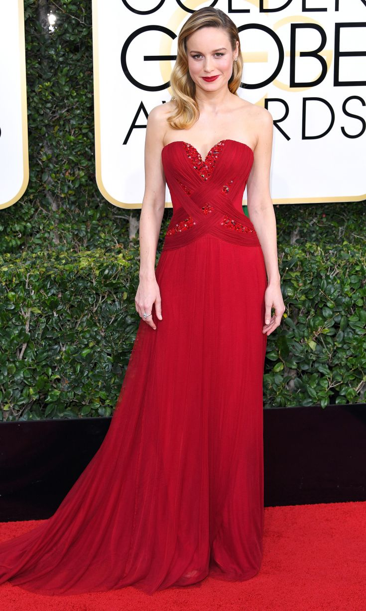 BRIE LARSON wears a scarlet sweetheart-neckline Rodarte gown with embellished bodice and matching lip, plus Forevermark jewelery.