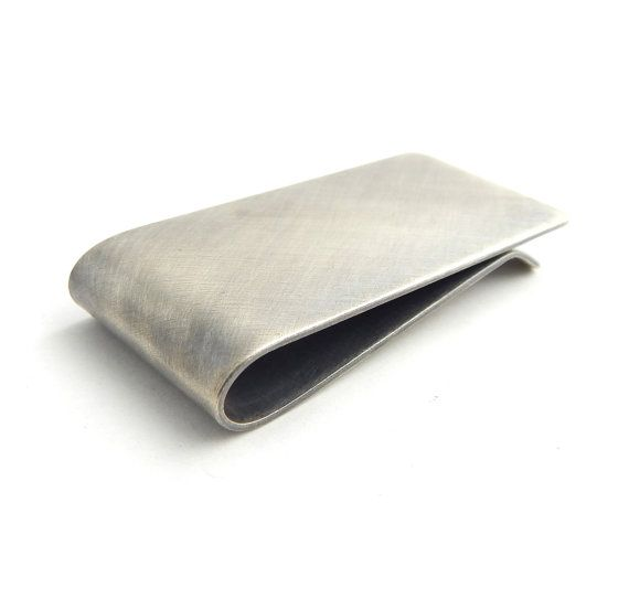 Thick and substantial, this solid sterling silver money clip is cut and shaped by hand so no two are exactly alike. Excellent gift for men or women!
